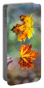 Couple Holding Autumn Leaves Portable Battery Charger