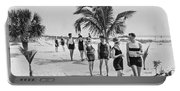 Couples Strolling Along The Pathway On The Beach. Portable Battery Charger