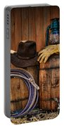 Cowboy Hat And Bronco Riding Gloves Portable Battery Charger by Paul Ward