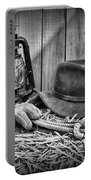 Cowboy Hat And Rodeo Lasso In A Black And White Portable Battery Charger by Paul Ward