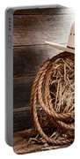 Cowboy Hat On Hay Bale Portable Battery Charger