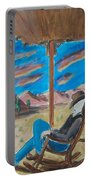 Cowboy Sitting In Chair At Sundown Portable Battery Charger