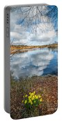 Daffodil Lake Portable Battery Charger by Adrian Evans