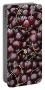 Dark Red Cherries In A Market Display Portable Battery Charger