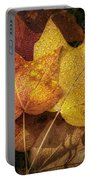 Dew On Autumn Leaves Portable Battery Charger by Scott Norris