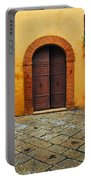 Door And Flowers In A Tuscan Courtyard Portable Battery Charger