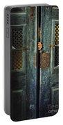 Door Peeking Portable Battery Charger by Carlos Caetano