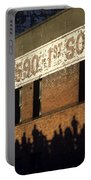 Downtown Seattle With Silhouetted Runners On Brick Wall Early Mo Portable Battery Charger
