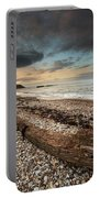 Driftwood Laying On The Gravel Beach Portable Battery Charger