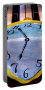 Dripping Clock On Piano Keys Portable Battery Charger by Garry Gay