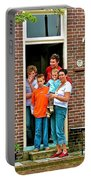 Dutch Family On Orange Day In Enkhuizen-netherlands Portable Battery Charger