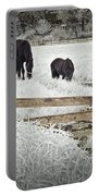 Dutch Friesian Horses Behind A Wooden Fence In A Pasture Portable Battery Charger
