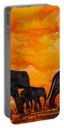 Elephants At Sunset Portable Battery Charger