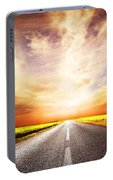 Empty Asphalt Road. Sunset Sky Portable Battery Charger