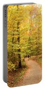Empty Trail Runs Through Tall Trees Portable Battery Charger