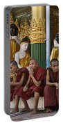 faithful Buddhist monks siiting around Buddha Statues in SHWEDAGON PAGODA Portable Battery Charger