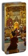 faithful Buddhists praying at Buddha Statues in SHWEDAGON PAGODA Yangon Myanmar Portable Battery Charger