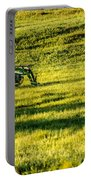Farm Equipment In A Field Portable Battery Charger