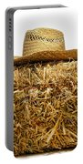 Farmer Hat On Hay Bale Portable Battery Charger