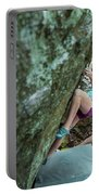Female Athlete Climbing On Boulder Portable Battery Charger