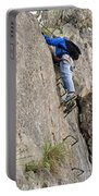 female climber on Via Ferrata Portable Battery Charger