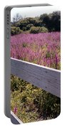 Fence And Purple Wild Flowers Portable Battery Charger