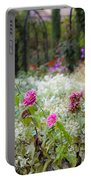Field Of Flowers On A Rainy Day Portable Battery Charger