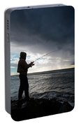 Fisherman Fishing While Storm Blows Portable Battery Charger