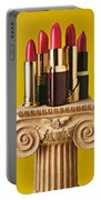 Five Red Lipstick Tubes On Pedestal Portable Battery Charger