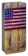 Flag On Old Yellow Door Portable Battery Charger