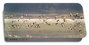 Flamingos Flying Over Water Portable Battery Charger