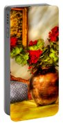 Flower - Geraniums On A Table  Portable Battery Charger by Mike Savad