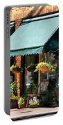 Flower Shop With Green Awnings Portable Battery Charger