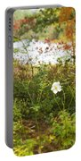Flowers Along The River In Fall Portable Battery Charger