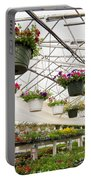 Flowers Growing In Foil Hothouse Of Garden Center Portable Battery Charger