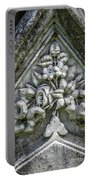 Flowers On A Grave Stone Portable Battery Charger by Edward Fielding