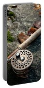 Fly Rod And Reel Detail On Mossy Wet Portable Battery Charger