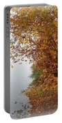 Foggy Autumn Riverbank Portable Battery Charger