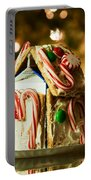 Gingerbread House Against A Background Of Christmas Tree Lights Portable Battery Charger