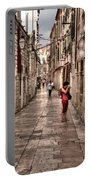 Girl In Red In The White Streets Of Dubrovnik Portable Battery Charger