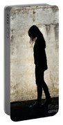 Girl Walking In Front Of Cement Wall Portable Battery Charger