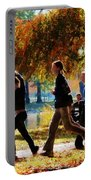 Girls Jogging On An Autumn Day Portable Battery Charger