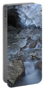 Glacial Creek Flowing From Blue Ice Portable Battery Charger