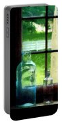 Glass Bottles On Windowsill Portable Battery Charger