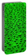 Green Drops On Water-repellent Surface Portable Battery Charger