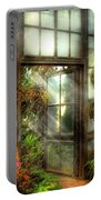 Greenhouse - The Door To Paradise Portable Battery Charger by Mike Savad