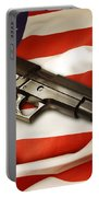 Gun On Flag Portable Battery Charger by Les Cunliffe