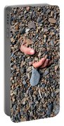 Hand In Gravel Portable Battery Charger by Stephan Pietzko