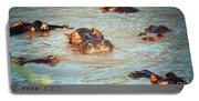 Hippopotamus Group In River. Serengeti. Tanzania Portable Battery Charger