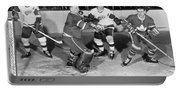 Hockey Goalie Chin Stops Puck Portable Battery Charger